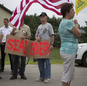 Protesters in Vasser, Michigan, marched from city hall Monday, July 14.