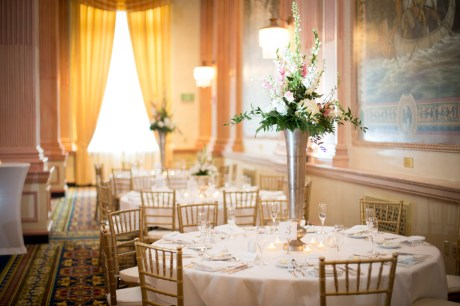 A tall floral centerpiece table arrangement