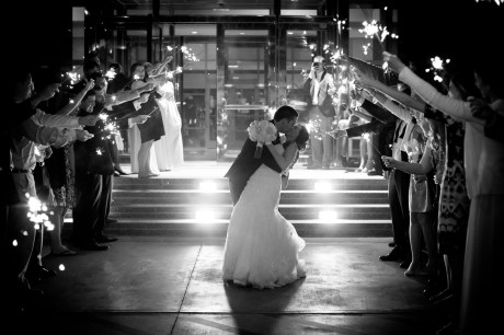 An epic kiss in a tunnel of sparklers