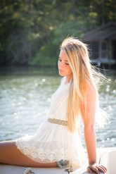 High school senior on a boat on the Magnolia River