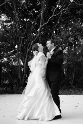 A bride and groom share a laugh during their first dance