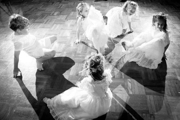 Flower girls dance during wedding reception