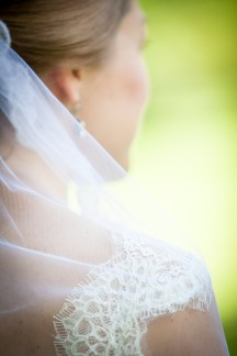 A delicate lace strap beneath the bridal veil