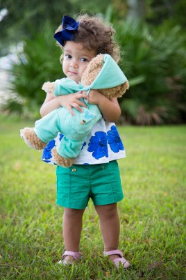 A toddler hugs her teddy bear in Fairhope, Alabama.
