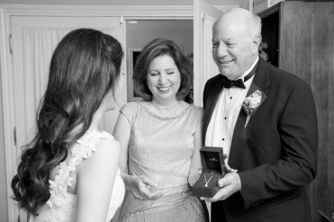 Mother- and father-of-the-bride present their daughter with a gift