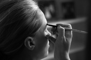 A bride gets the final touches applied to her make-up