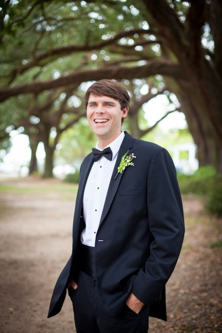 A groom in a classic black tuxedo