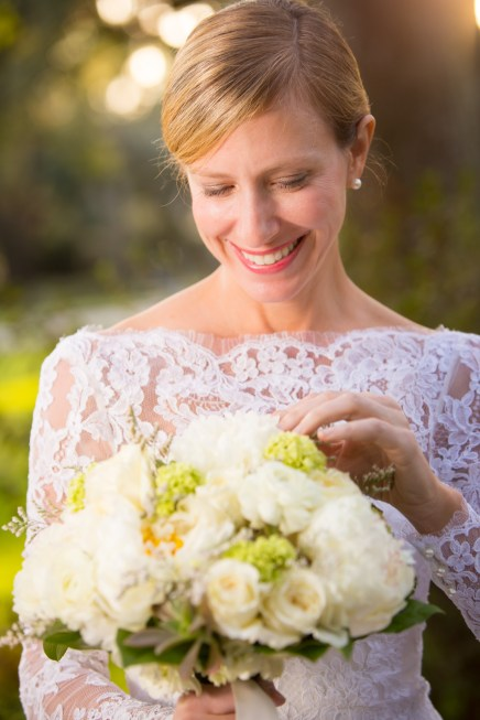 A bride looks at her bouquet