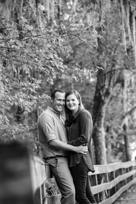 A happy couple embraces on the boardwalk at Historic Blakeley State Park in Spanish Fort, Alabama