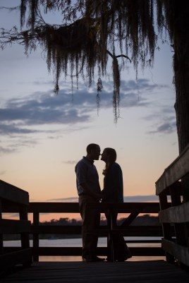 The silhouette of a young couple before they kiss