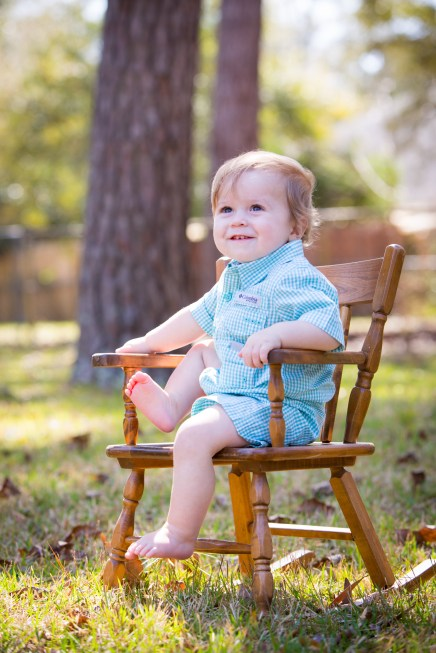 Precious one-year-old in rocking chair