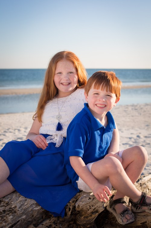Red-headed brother and sister on the beach