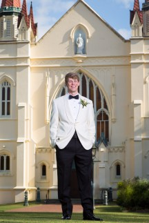 The groom at St. Joseph Chapel on the campus of Spring Hill College