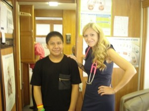 Alex with Nurse Practitioner Amy