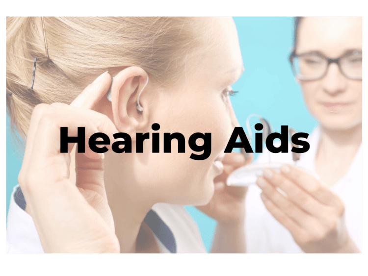 Woman testing an invisible hearing aid with her female doctor