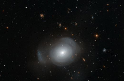 "131014-galaxy Hubble Video: Galaxies Collide, Gorgeous ""Cosmic Bloom"" Results"