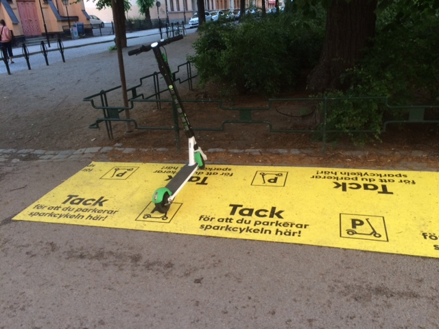 Parking lot for kick scooters