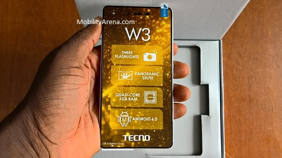 TECNO W3 Photos phone in hand