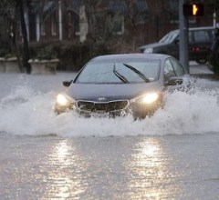 Car on flooded streets