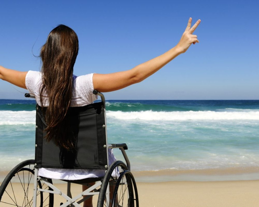 cropped-wheelchair-in-the-surf-1.jpg