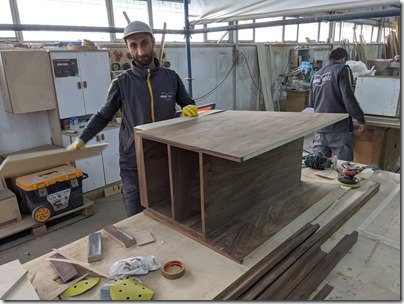 Omer smiling with cabinet
