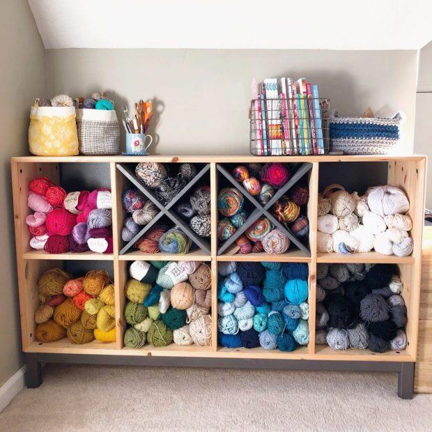 Shelf with yarn organized by color