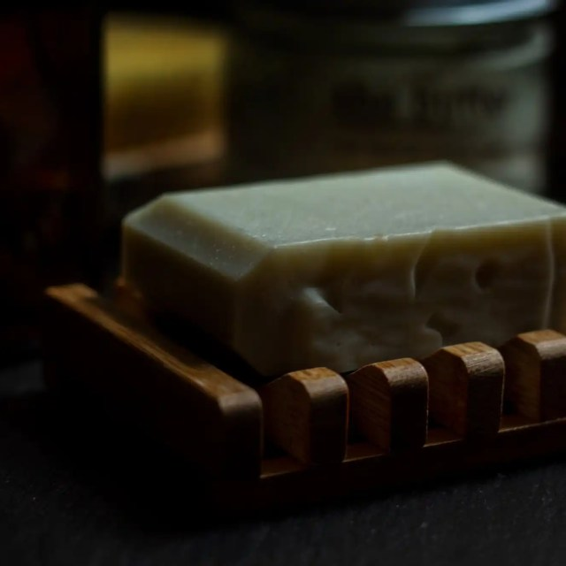Bar soap on bamboo dish