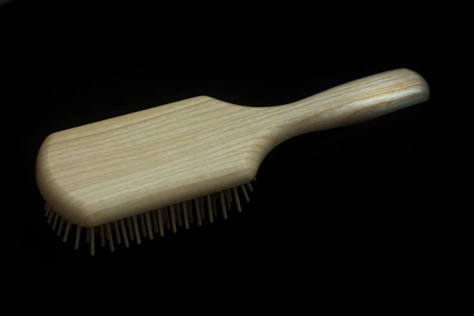 Widu Hair Brush on black background