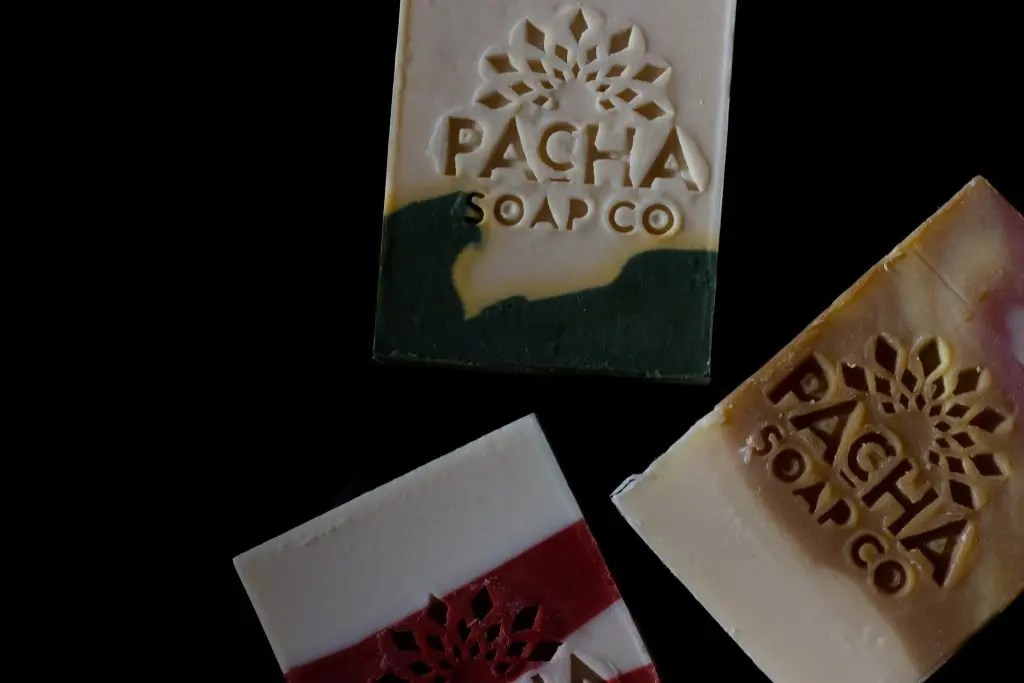 bars of pacha soap on black background