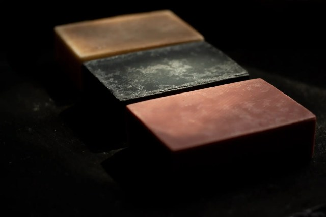 Three Rose and Water bar soaps on a slate board