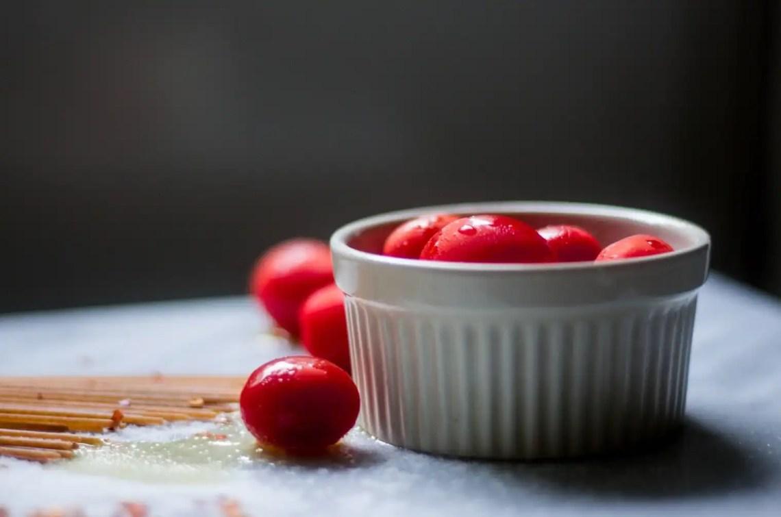 Adobe Lightroom photography edit: grape tomatoes in white ramekin on marble board