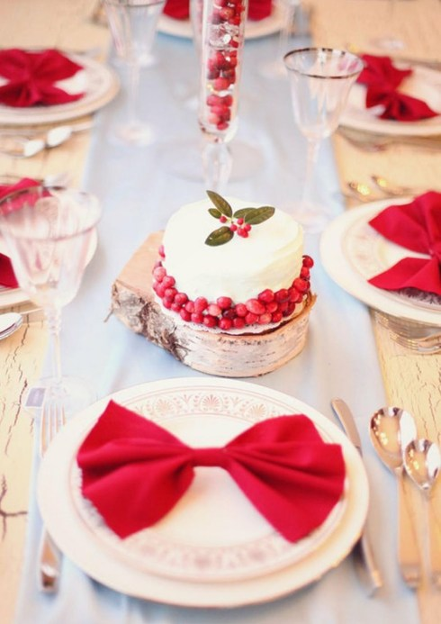 Sweetly vibrant, warm, beautiful Christmas table setting with bows and pomegranate seeds