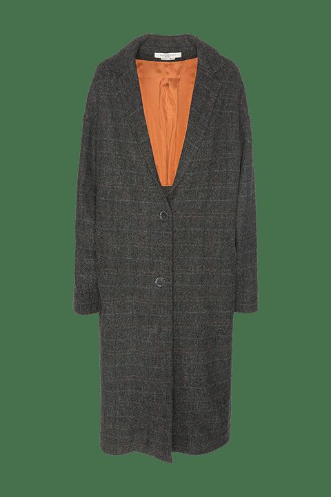 Abrigo de espiga con rayas de colores que forman cuadros.