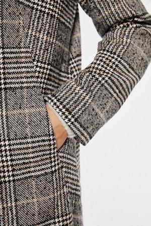 Rut and Circle. Detalle del cuadro del abrigo Becka y los bolsillos laterales.