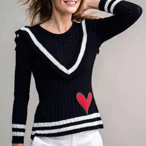 Jersey de punto negro con detalle de rayas blancas en volante y hombros. Rosalita Mc Gee.