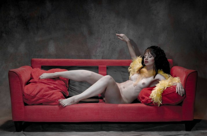 she_is_on_a_red_couch_by_jrekas-d98hi8h