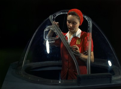 "This girl in a glass house is putting finishing touches on the bombardier nose section of a B-17F navy bomber, Long Beach, Calif. in October 1942. She's one of many capable women workers in the Douglas Aircraft Company plant. Better known as the ""Flying Fortress,"" the B-17F is a later model of the B-17 which distinguished itself in action in the South Pacific, over Germany and elsewhere. It is a long range, high altitude heavy bomber, with a crew of seven to nine men, and with armament sufficient to defend itself on daylight missions. (Alfred T. Palmer/U.S. Office of War Information/Library of Congress)"