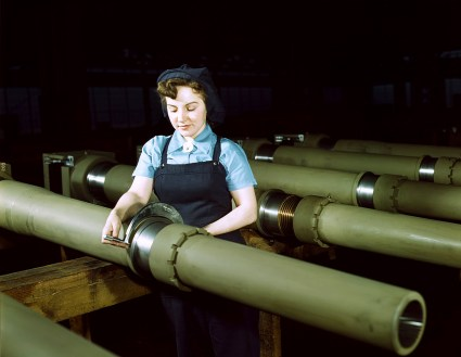 Gist inspector, Mrs. Mary Betchner inspecting one of the 25 cutters for burrs before inserting it in the inside of a 105mm. howitzer at the Milwaukee, Wis. plant of the Chain Belt Co. in February 1943. Her son is in the army; her husband is in war work. (Howard R. Hollem/U.S. Office of War Information/Library of Congress)