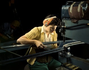 "A girl riveting machine operator at the Douglas Aircraft Company plant joins sections of wing ribs to reinforce the inner wing assemblies of B-17F heavy bombers, Long Beach, Calif. in October 1942. Better known as the ""Flying Fortress,"" the B-17F bomber is a later model of the B-17, which distinguished itself in action in the south Pacific, over Germany and elsewhere. It is a long range, high altitude, heavy bomber, with a crew of seven to nine men -- and with armament sufficient to defend itself on daylight missions. (Alfred T. Palmer/U.S. Office of War Information/Library of Congress)"