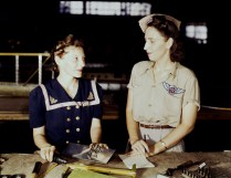 Pearl Harbor widows have gone into war work to carry on the fight with a personal vengeance, Corpus Christi, Texas in August 1942. Mrs. Virginia Young (right) whose husband was one of the first casualties of World War II, is a supervisor in the Assembly and Repairs Department of the Naval Air Base. Her job is to find convenient and comfortable living quarters for women workers from out of the state, like Ethel Mann, who operates an electric drill. (Howard R. Hollem/U.S. Office of War Information/Library of Congress)