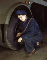 War production workers at the Heil Company making gasoline trailer tanks for the U.S. Army Air Corps., Milwaukee, Wisconsin in February 1943. Mrs. Angeline Kwint, age 45, an ex-housewife, checking the tires of trailers. Her husband and son are in the U.S. Army. (Howard R. Hollem/U.S. Office of War Information/Library of Congress)