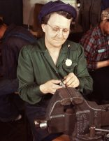 War production worker at the Vilter Manufacturing Company making M5 and M7 guns for the U.S. Army, Milwaukee, Wis. in February 1932. Ex-housewife, age 49, now doing bench work on small gun parts. Son is Second Lieutenant, Son-in-law, Captain in Army. (Howard R. Hollem/U.S. Office of War Information/Library of Congress)