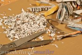 Möglichst kleine Papierschnipsel aus einer alter Zeitung schneiden