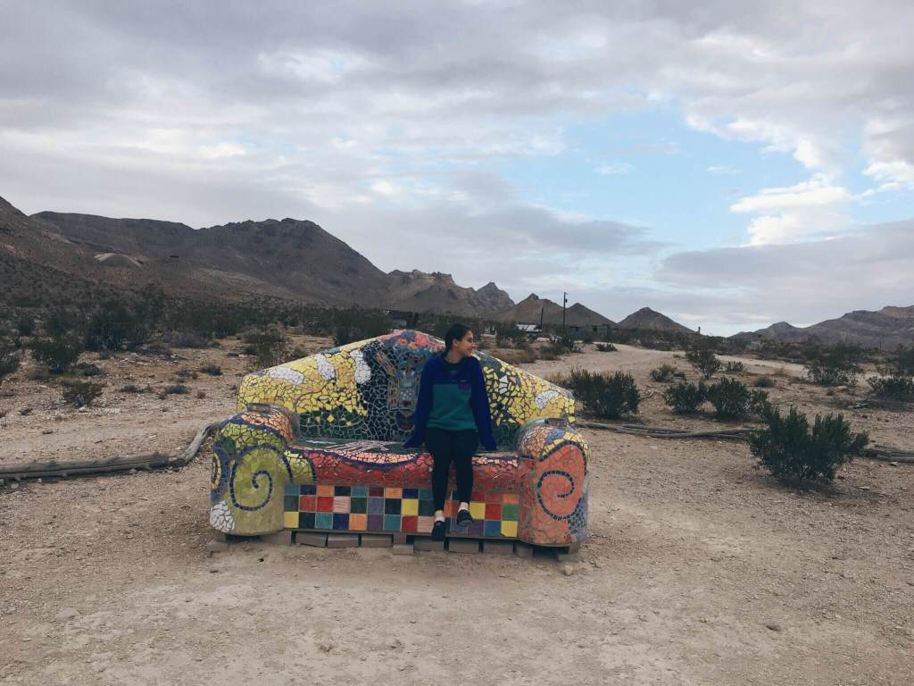Rebecca on the mosaic bench in Rhyolite Ghost Town, Nevada near Death Valley National Park