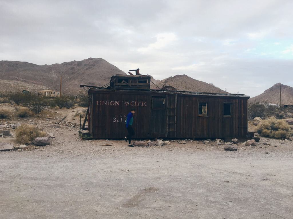 Old train caboose that once served as a gas station, Rhyolite Ghost Town, Nevada near Death Valley National Park