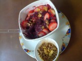 A big bowl of frozen Açaí with strawberries and Granola in Brazil