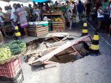 Massive pot-hole appears in a market in Brazil