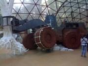 Brazilian tree-hugger truck  tipping over inside a glass dome at Inhotim, Minas Gerais
