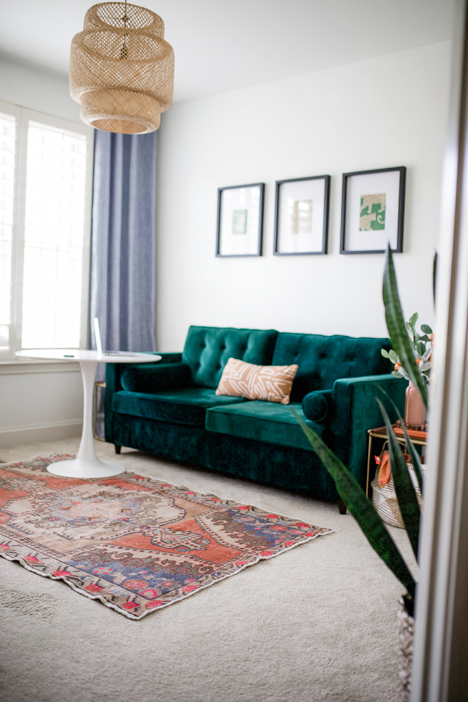 What to Look for When Buying Furniture Online by popular lifestyle blog, Modern Day Moguls: image of a room with a Joybird tuft velvet couch, joybird end table, and orange oriental rug.