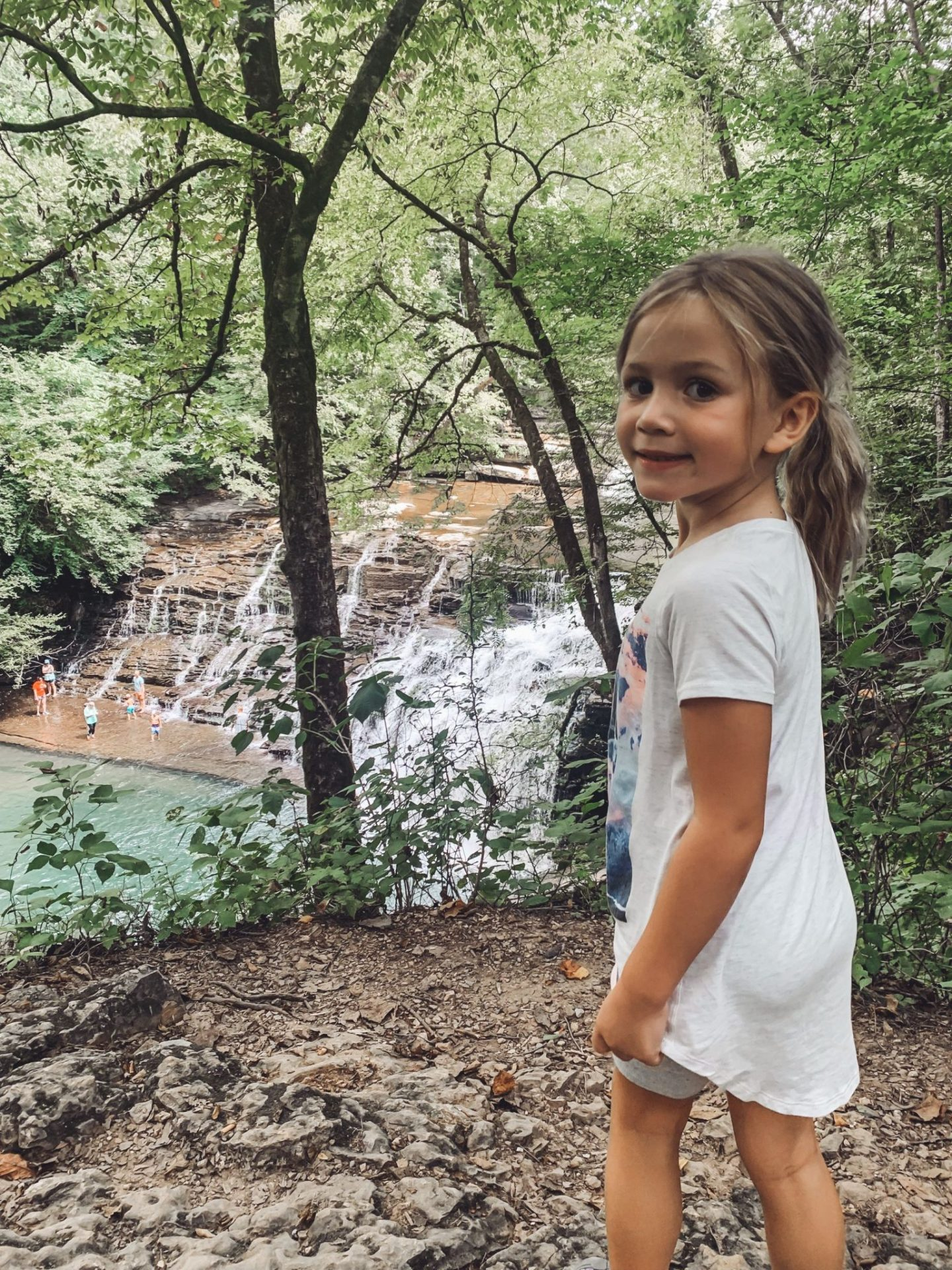 Family-Friendly Waterfall Hiking Trails in Nashville, TN by popular Nashville blog, Modern Day Moguls: image of a girl standing next to Rutledge Falls in Tullahoma, TN.